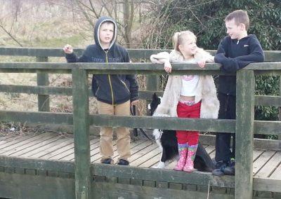 Children on a wooden bridge